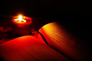 Reading by the candle